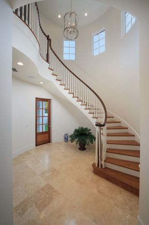 Traditional Staircase with Pendant light, picture window, High ceiling, can lights, Hardwood floors, curved staircase