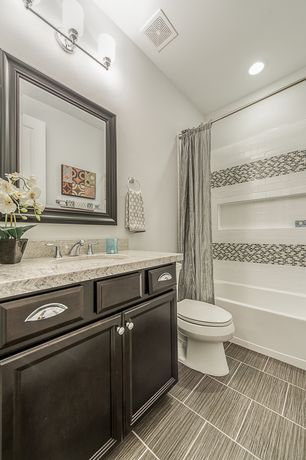 Traditional Full Bathroom with specialty tile floors, specialty door, Flat panel cabinets, Undermount sink, Complex Granite