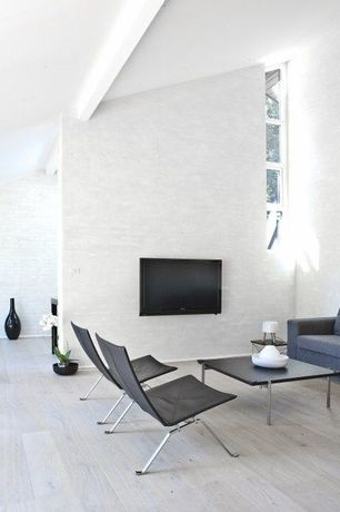 Contemporary Living Room with Leather harness black chair, Rubik coffee table, Hardwood floors, Exposed beam