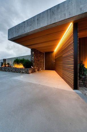 Contemporary Front Door with six panel door, exterior concrete tile floors, Fence, Fire pit, Pathway, exterior tile floors