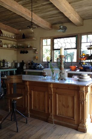 Rustic Kitchen with L-shaped, single dishwasher, gas range, flush light, Simple marble counters, Kitchen island, Exposed beam