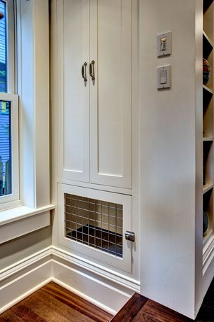 Craftsman Hallway with Hardwood floors, Built in pet kennel, Jeffrey Alexander Kensington Pull, Built-in bookshelf
