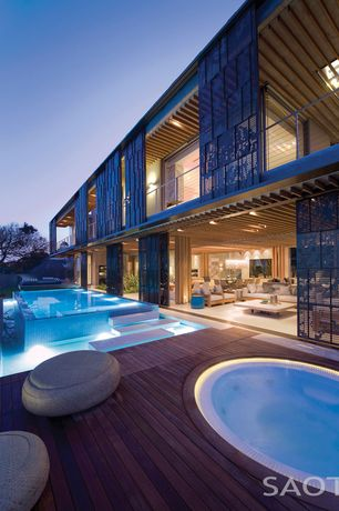 Modern Exterior of Home with Other Pool Type, Fence, Deck Railing