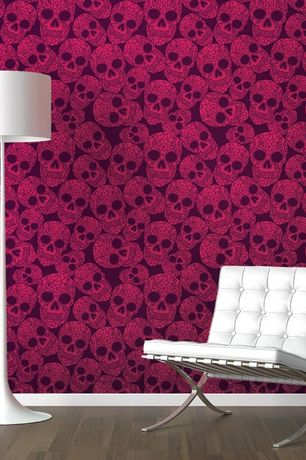 Contemporary Living Room with Laminate floors, Barcelona leather chair, Flos- spun light floor lamp, Astek inc- sugar skulls