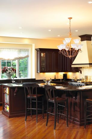 Traditional Kitchen with Simple Granite, Raised panel, L-shaped, Casement, Undermount sink, Kitchen island, electric cooktop