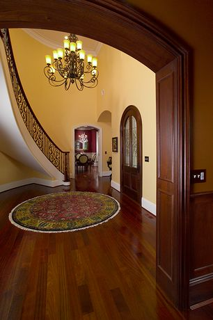 Traditional Entryway with Glass panel door, High ceiling, Crown molding, Vaughn round area rug, Hardwood floors, Chandelier