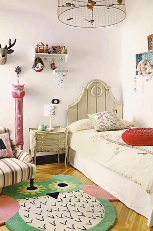 Eclectic Kids Bedroom with Hardwood floors