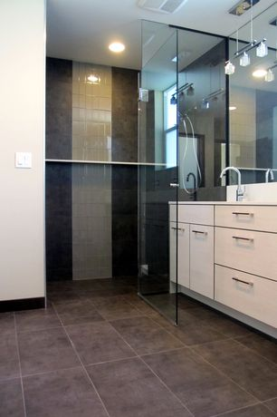 Modern Master Bathroom with Pendant light, European Cabinets, frameless showerdoor, Handheld showerhead, Corian counters