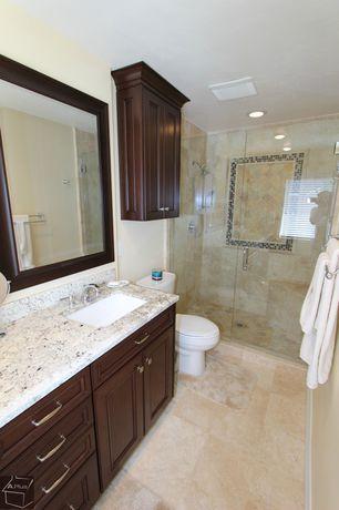 Modern Master Bathroom with Simple granite counters, stone tile floors, can lights, Handheld showerhead, Undermount sink