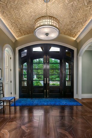 Contemporary Entryway with Transom window, Arched doorway, Decorative ceiling, Hardwood floors, Crown molding, flush light