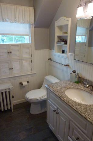 Cottage Powder Room with Powder room, wall-mounted above mirror bathroom light, Casement, slate tile floors, Raised panel