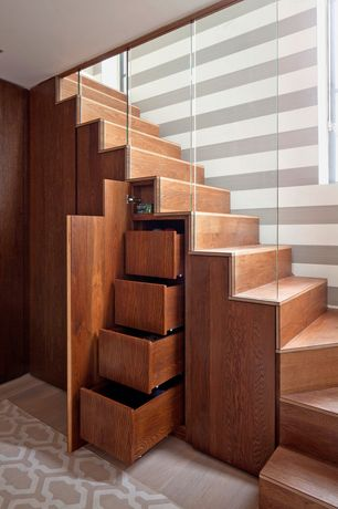 Contemporary Staircase with Oak stairs and shelving, Built-in bookshelf, Hardwood floors, interior wallpaper, High ceiling