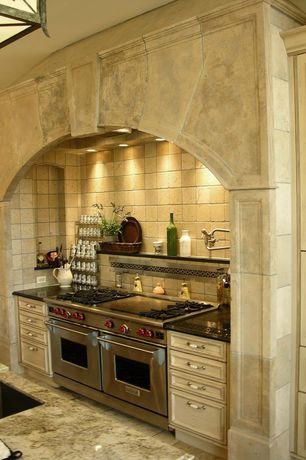 Mediterranean Kitchen with Daltile fidenza dorado tile, Complex granite counters, Viking vgcc5486gss range, Stone Tile, Flush