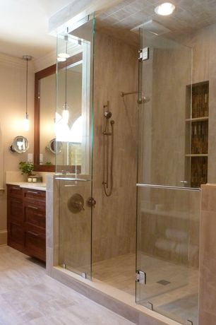 Modern Master Bathroom with Arched window, Flat panel cabinets, Handheld showerhead, Undermount sink, Travertine counters