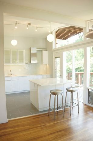 "Modern Kitchen with Ceramic Tile, European Cabinets, Pendant light, 11"" globe pendant, Twist swivel stool, High ceiling"