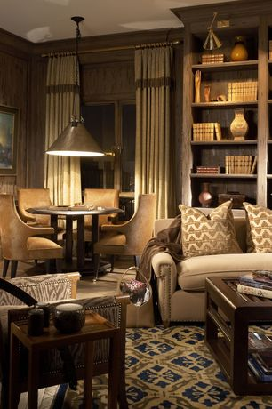 Eclectic Living Room with Comfort Pointe Knox Oval Back Accent Chair, Built-in bookshelf, Hardwood floors, Pendant light