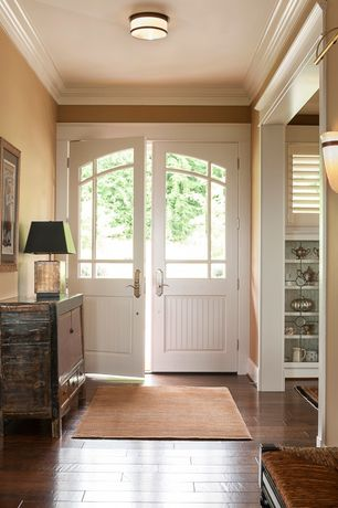 "Traditional Entryway with Paint 1, Standard height, Feiss casual luxury 13"" wide ceiling light fixture, Hardwood floors"