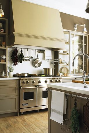Country Kitchen with Standard height, full backsplash, flush light, Wood counters, Wall sconce, Glass panel, Flush, One-wall