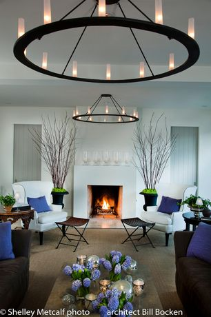 Contemporary Living Room with flat door, can lights, Fireplace, Chandelier, Cement fireplace, Box ceiling, Carpet