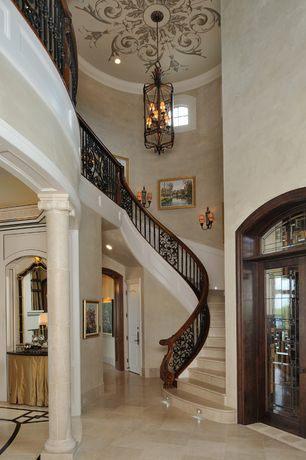 Traditional Staircase with Wall sconce, Paint, Cathedral ceiling, Chandelier, stone tile floors, Crown molding, can lights