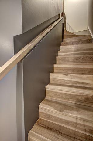 Modern Staircase with Hardwood floors