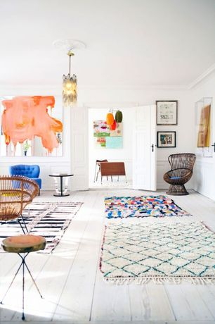 Eclectic Living Room with specialty door, Deny designs garima dhawan rain 6 area rug, Hardwood floors, Chair rail, Paint 1