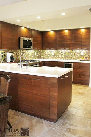 Modern Kitchen with Undermount sink, MS International 12x24 Tuscany Classic Travertine Tile, U-shaped, Destiny: slab cabinets