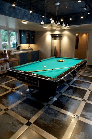 Modern Game Room with Casement, Concrete floors, High ceiling, flush light, Pendant light, can lights, six panel door