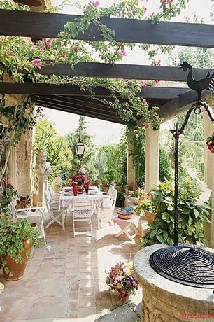 Cottage Patio with exterior stone floors, Trellis, Outdoor dining, Pergola