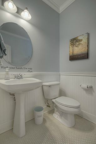 Contemporary Powder Room with penny tile floors, Crown molding, High ceiling, Pedestal sink, Howard Elliott Round Mirror