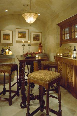 Eclectic Wine Cellar with sandstone floors, can lights, flush light, Built-in bookshelf, Casement, Standard height