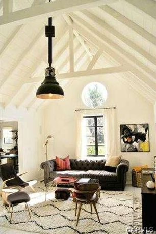 Eclectic Living Room with Carpet, Pendant light, High ceiling, Exposed beam