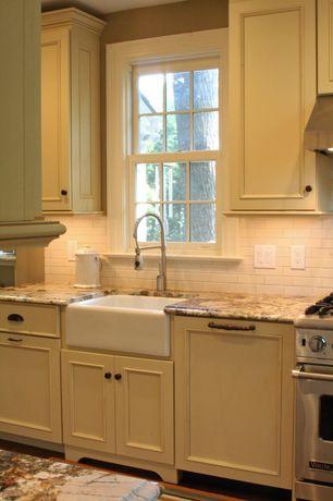 Country Kitchen with full backsplash, Framed Partial Panel, Complex granite counters, Wall Hood, Ogee countertop edge