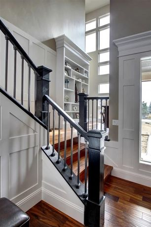 Traditional Staircase with High ceiling, Hardwood floors, Built-in bookshelf, Wainscotting