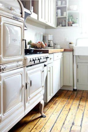 Country Kitchen with Hardwood floors, dishwasher, High ceiling, Wood counters, Subway Tile, Flush, full backsplash, L-shaped