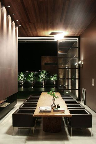 Contemporary Dining Room with Standard height, Live edge table, Paint, can lights, Wall washers lighting, flush light
