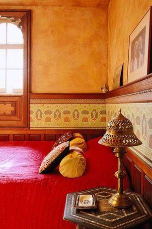 Mediterranean Master Bedroom with Pottery barn branson quilt, Safavieh matthew hexagon end table