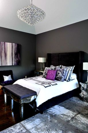 Contemporary Master Bedroom with Black leather tufted bench, Hardwood floors, Chrome bedside lamp, Chandelier