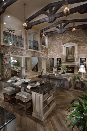 Traditional Great Room with Casement, Fireplace, Columns, French doors, Cement fireplace, Chandelier, Balcony, Exposed beam