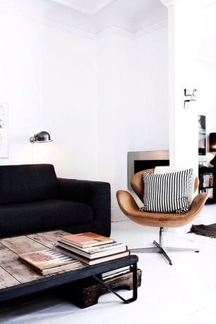 Modern Living Room with Design Within Reach Reid Sofa, Hardwood floors, metal fireplace, Crown molding, Wall sconce