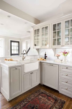 Traditional Kitchen with Farmhouse sink, Inset cabinets, Subway Tile, Flat panel cabinets, Glass panel, Crown molding