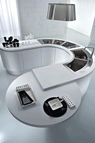 Modern Kitchen with Corian counters, Pendant light, Concrete tile , Pedini artika curved cabinets