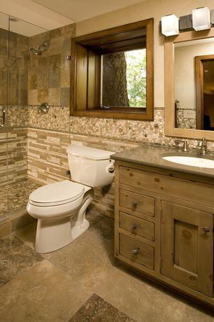 Craftsman 3/4 Bathroom with Standard height, Inset cabinets, Chair rail, three quarter bath, stone tile floors, Shower
