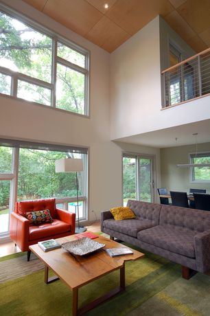 Modern Living Room with can lights, Casement, Laminate floors, picture window, Loft, High ceiling