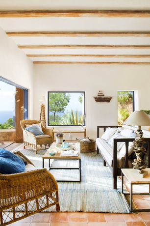 Contemporary Living Room with Exposed beam, terracotta tile floors