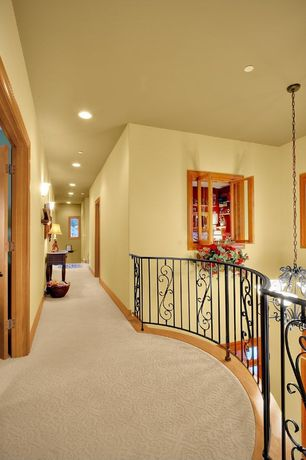 Eclectic Hallway with Carpet, Balcony, Wall sconce