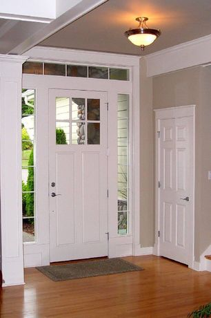 Traditional Entryway with Hand scraped maple sedona,click lock hardwood flooring, Six panel entry door, Transom window
