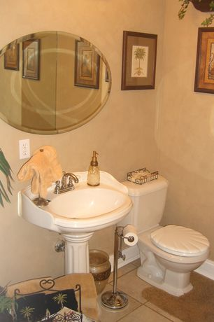 Traditional Powder Room with Powder room, limestone tile floors, Spancraft Regency 24 x 36 Oval Beveled Edge Mirror