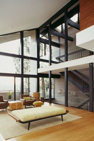 Contemporary Living Room with Loft, Cathedral ceiling, Exposed beam, Laminate floors, Pendant light