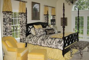 Traditional Master Bedroom with Glass panel door, Carpet, Arched window, Chandelier, High ceiling